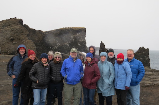 A group of Dartmouth alumni, parents and friends visit Iceland in April 2017, accompanied by Math Prof. <span class='showcase'>Dorothy Wallace</span> who gave a talk on the probability of eruption of the volcano Katla. This photo is taken at the place where the mid-Atlantic ridge rises out of the sea.