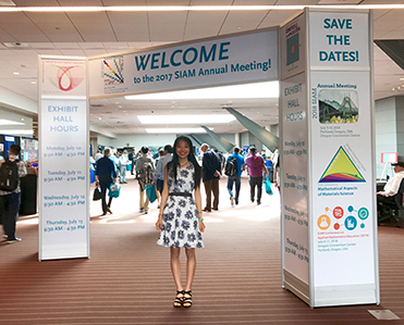Yixuan He '18 was one of twelve undergraduate students invited to give a talk at the <a href='http://www.siam.org/meetings/an17/'>2017 SIAM Annual Meeting</a>, where she presented on her research with Professor Dorothy Wallace on a model of cancer tumor growth.